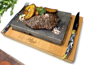 Deer steak on a heated stone